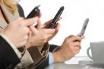 Multiple phones in hands - horizontal